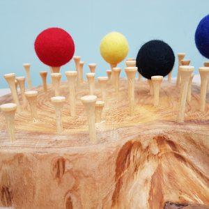 Golf tees, wool felted balls. wool balls. loose parts play, balancing game